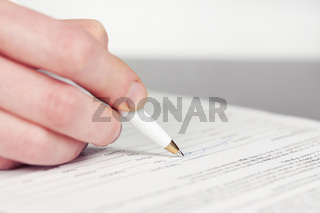 Business woman signing contract