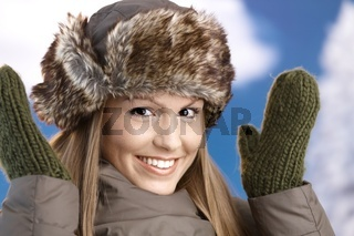 Attractive girl dressed up for winter fun smiling