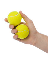 Hand with tennis balls