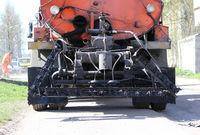 Machine for asphalt road with liquid black bitumen in the tank