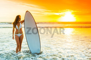 Woman with surfboard