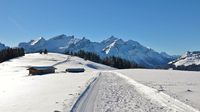 Winter hiking and sledging trail on mount Hoge Wispile. Mountain landscape near Gstaad, Switzerland.