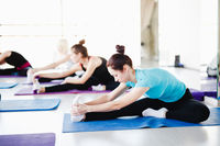 Group of girls doing stretching exercise