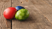 Colored Easter eggs on wood