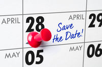 Wall calendar with a red pin - April 28