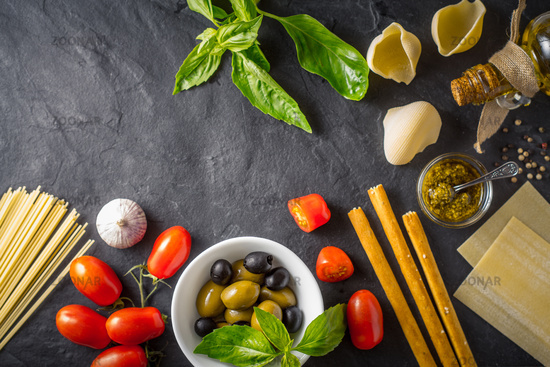 Italian food still life on the dark table top view