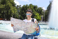 Tourist woman searching direction on location map