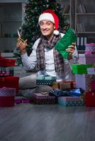 Man with many christmas gifts in boxes