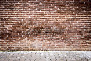 Brown brick wall.