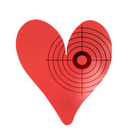 Target on a metal heart-shaped object