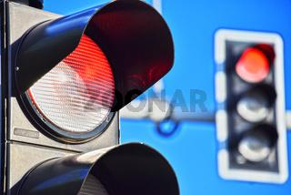 Traffic lights over blue sky. Red light