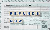 Macro close up of 2017 IRS form 1040 with REFUNDS NOW letters