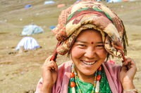 Smiling woman with beads in Nepal