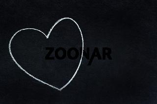 Heart shape written in white chalk
