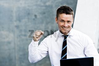 Closeup Of A Corporate Successful Man With Laptop