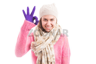 Young lady showing perfect okay gesture wearing warm clothes