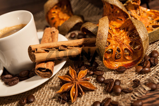 Close-up of cup of coffee with cinnamon and star anise