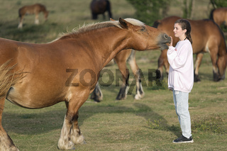 Teenager with Horses in a meadow
