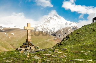 Cross in mountains