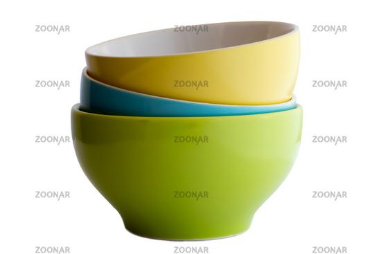Three ceramic bowls: green, blue, yellow