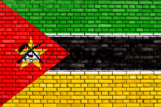 flag of Mozambique painted on brick wall