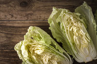 Two halves of chinese cabbage on old boards