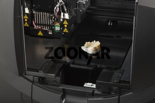 3D Printer With Finished 3D Printed Dental Implant Bridge