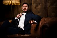 Rich businessman with cigar