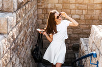 Young beautiful woman against a stone wall