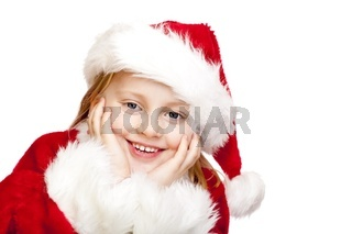 Mädchen als Weihnachtsmann bzw. Weihnachtsfrau verkleidet lacht