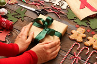Female hands over christmas gift