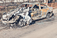 Abandoned and burnt-out car.