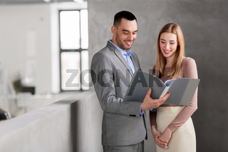 businesswoman and businessman with folder