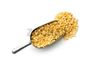 Yellow split peas in metal scoop.