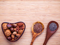 Selection food sources of omega 3 and unsaturated fats. Super food high vitamin e and dietary fiber for healthy food. Almond ,pecan ,hazelnuts,walnuts ,flax seed and chia seed on bamboo cutting board.