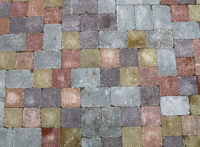 Street road stone paving of multicolor bricks