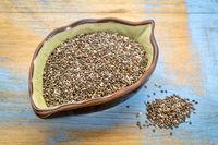 black chia seeds in a leaf bowl