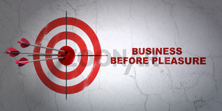Finance concept: target and Business Before pleasure on wall background