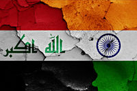 flags of Iraq and India painted on cracked wall