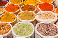 Indian spices and seasoning in bags at traditional street market