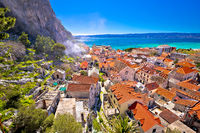 Town of Omis coast and rooftops panoramic view