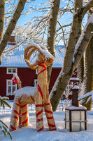 Lantern and a Christmas goat in a garden in the winter