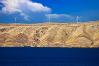 Stone desert island of Pag wind power plants view