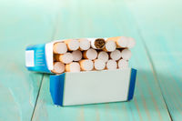 Pack of cigarettes on a blue wooden background