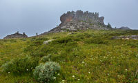 Castles of mountain spirits are cliffs in the fog located in vicinity of Karakol lakes. Altai Krai.