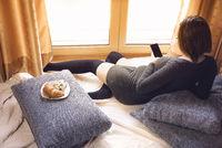 Pregnant redhead woman using a smartphone