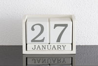 White block calendar present date 27 and month January