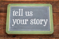 Tell us your story - text on slate blackboard