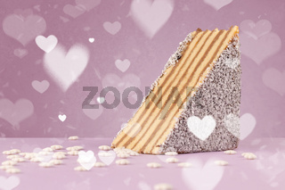 Delicious party cakes with heart shape symbols on colorful background
