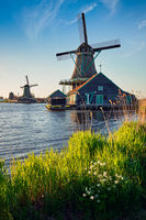 Windmills at Zaanse Schans in Holland on sunset. Zaandam, Nether